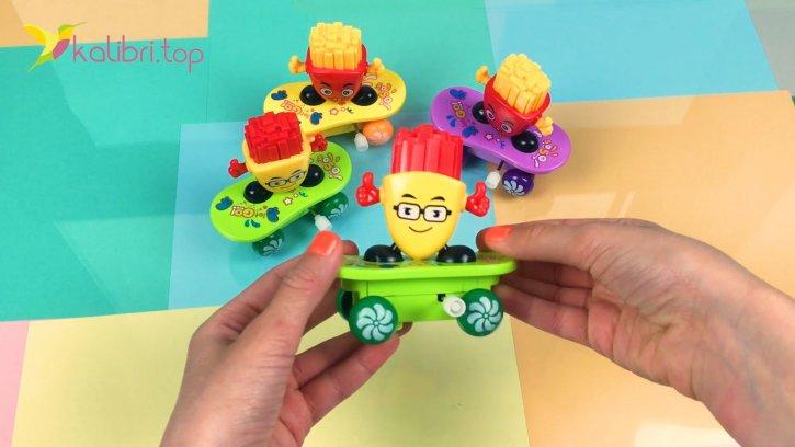 Заводная детская игрушка картошка фри на скейте оптом изображения 2